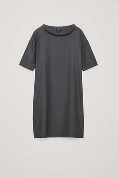 A classic style, this short-sleeved dress is made from a light, draped cotton blend. Cut for a relaxed fit with dropped shoulders, it has a shaped centre-back seam and discreet side pockets. Back length of size 36 is / Model is tall and wearing a size 38 Charcoal Dress, Short Sleeve Dresses, Dresses With Sleeves, Draped Dress, White Shirts, New Product, Classic Style, Shirt Dress, Cos