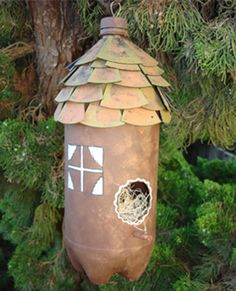 Make a bird house or bird feeder from a 2 liter soda bottle. This is a really cute design, but you will want a stick under the hole for the bird to sit and eat.