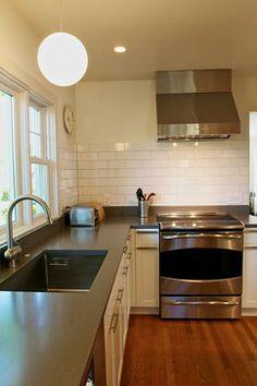 White cabinets w subway tile, grey countertops. Bryant Kitchen modern kitchen