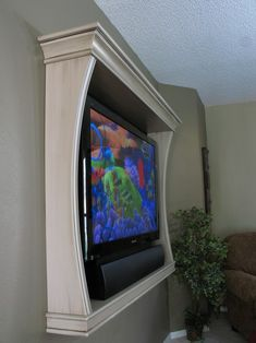 finally found the solution to my desire to put the flat screen on a side wall in my family room! Do It Yourself Furniture, Diy Furniture, Furniture Plans, Tv Emoldurada, Deco Tv, Muebles Living, Framed Tv, Wall Mounted Tv, Home Interior