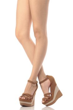 The perfect pair of wedges to complete your look! This pair features a faux nubuck material, adjustable ankle strap, color contrast, strappy design and cushioned insoles. Wear these wedges with your favorite A line dress to perfect your Spring look.-True to size