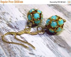 "Vintage Ball Earrings with brass and opaque turquoise rhinestones. Simple and light.   Made in the USA  Measures 1 1/2""  Beads are 10mm ➡️ https://www.etsy.com/listing/463254611/sale-vintage-turquoise-brass-ball?utm_campaign=products&utm_content=b96d8cd5805341528601889aae69cde1&utm_medium=pinterest&utm_source=sellertools"