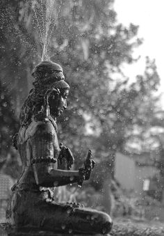 Water Fountain at Golden Sun Beach Resort, ECR, Chennai, India. Water flowing out of hindu god Shiva's head shot with high shutter speed. Photo by Viswaakshan