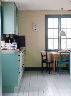 Simple kitchen with painted wood floors.