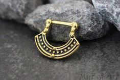 Product Information - Product Type: Clicker in 316L Surgical Stainless Steel - Gauge Size: 16 Gauge (1.2mm) Total Size: 15mm(L)*17mm(W)*1.5mm(T) Tribal Gold Septum Clicker Ring Hoop Piercing Jewelry J