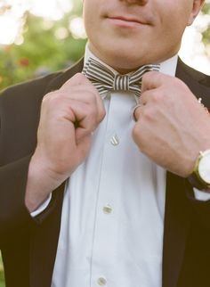 styled groom in striped bow-tie