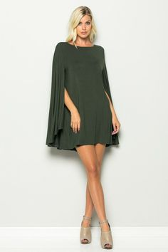 The hottest style of the year! This cape swing dress easily works for day or night. It would be great for that office party or any red carpet. View Size Chart