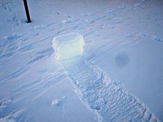 sunlights shining through a snow roller, snowrollers,, snow tumbleweed, rare weather phenomenon