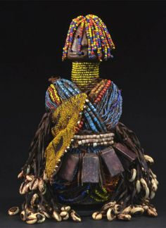 Africa | Fali doll from northern Cameroon | Wood, glass beads, leather strips, cowrie shells, leather amulets, iron amulets
