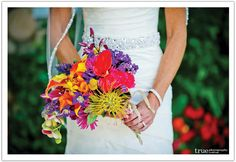 A vibrant tropical bouquet for a San Diego beach wedding.  Flowers by Isari Flower Studio, Design by Alchemy Fine Events