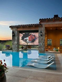Gorgeous swimming pool with fab big screen tv built in.