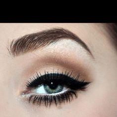 Heavy black eyeliner with white eyeliner on the waterline