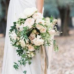 A romantic blush and rose gold woodland wedding that blends pastels and metallics with glittering pumpkins and fresh florals for beauty in any season!