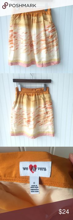 """•We Love Vera• Goldfish Skirt Anthropologie We Love Vera skirt with subtle goldfish pattern of orange, yellow, gold and pink.  Side zipper. Front pockets.  Fully lined.  Small spot on bottom hem on back of skirt (I haven't tried to remove it, but I'm hopeful it would come out).  Otherwise, a tad wrinkly but great condition.  Size 0.  Approximate measurements: Waist - 12.5""""; Length - 20"""" Anthropologie Skirts"""