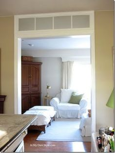 Faux transom using mirrored panes.