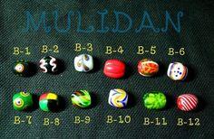 排灣琉璃珠 Paiwan (one of Taiwan's indigenous groups) glass beads...Colors have special meanings in different cultures and the Paiwan is no different.     Me want!