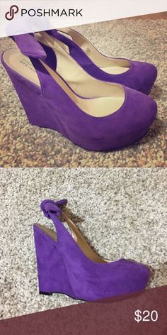 Purple wedges Elizabeth Brady purple wedges. Worn once for special event. Bow on back can be taken off. Size 8 Shoes Wedges