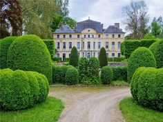 Catherine Deneuve's house in Normandy, Chateau de Primard, with grounds designed by famed Belgian landscape architect Jacques Wirtz.