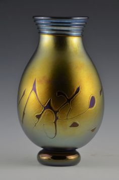 Gold Lustre Tear Drop Vase by Donald Carlson. A nice gold lustre footed tear drop vase with spiral lip wrap. This piece is made using Carlson art glass' own glass formulas.