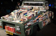 """Drop knowledge, not bombs.""    Artist Raul Lemesoff drives around the streets of Buenos Aires in a converted tank he calls ""Arma De Instruccion Masiva"" (Weapon of Mass Instruction), delivering thousands of donated books to rural areas, schools, and low-income children."