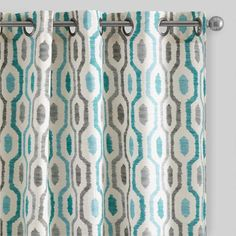 Crafted of 100% cotton, our exclusive grommet-top curtains feature a playful geometric design in cool teal and soft gray hues with a subtle printed texture.