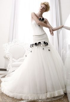 Luxury wedding dress with strapless neckline and full tulle skirt. Features black flowers on the bodice and skirt. Free made-to-measurement service for any size. Available colors seen as in Color Options.