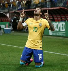 Brazil's forward Neymar celebrates after scoring against Paraguay during their 2018 FIFA World Cup qualifier football match in Sao Paulo Brazil on March 28 / AFP PHOTO / Miguel SCHINCARIOL Brazil Football Team, Brazil Team, Football Match, Brazil Brazil, Brazil World Cup, Fifa World Cup, Neymar Images, Neymar Vs, World Cup Qualifiers
