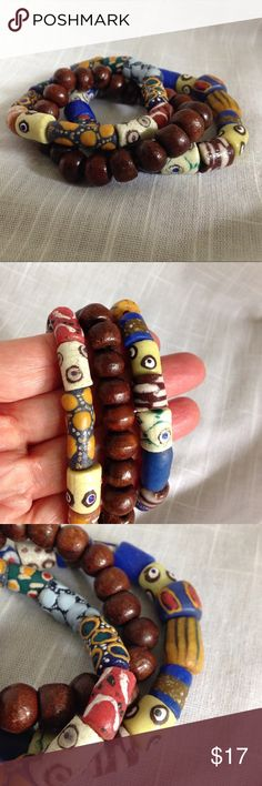 African Trade Beads Stretchy Bracelets Two African trade beads bracelets and one wooden beads. All on Stretchy cords. Measure about 2.5 inches in diameter. Real Tribal or Boho look! Don't forget to bundle for even greater savings!❤️❤️ Jewelry Bracelets