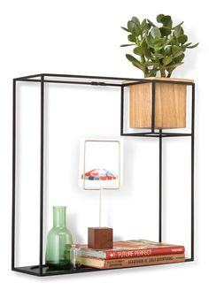 An ultra modern display shelf that appears to be floating on your wall. Its form meeting function at its best!  Features:  - Modern organiser shelf that visually floats your things - Can hold books, figurines, frames or a combination of different personal items - Wooden cup can become a tumbler for small pieces or a pot for small plants (with plastic insert) - Create an interesting wall collage with a decorative clock, wall dcor or some frames - Rod frame with vessel and tray that easily…