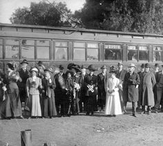 The first Red Car over to North Hollywood, December 16, 1911, Van Nuys Line. Far right: Fred Weddington, who negotiated to get the line in the Valley; 9th from right: Wilson C. Weddington. The train behind was Huntington's special car. Weddington Family Collection. San fernando Valley History Digital Library.