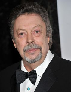 """Timothy James """"Tim"""" Curry (born 19 April 1946) is an English actor, singer, and composer. His first notable role was as Dr Frank-N-Furter in The Rocky Horror Picture Show. Other roles included Wadsworth in the mystery comedy film Clue, Pennywise in the 1990 horror miniseries It, and Nigel Thornberry on the animated  series The Wild Thornberrys. Stage roles include Wolfgang Amadeus Mozart in the 1980 Broadway production of Amadeus and King Arthur in Spamalot from 2005 to 2007."""