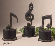 Uttermost Music Notes Metal Figurines. Hand forged metal finished in aged black with a tan glaze and matte black accents. Sizes: Sm-5x11x3, Med-5x12x3, Lg-5x12x3