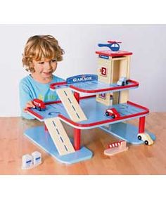 Buy Chad Valley Wooden Garage Playset at Argos.co.uk - Your Online Shop for Toy cars, trains, boats and planes , Toy cars, vehicles and sets, Pre-school, Limited stock Toys and games.