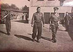 Arrest of Josef Kramer, last Commandant of Auschwitz who moved operations to Bergen-Belsen at the end of 1944 when Auschwitz was evacuated. Kramer is shown under arrest by British military. He was tried as a war criminal and hanged.