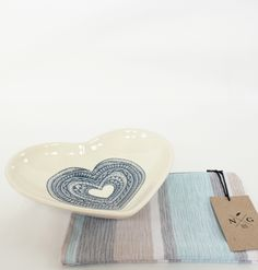 The Sophia Clutch is handmade in South Africa and is perfect as a mini handbag, make-up bag or a bag for any other must have items. The fabric patterns on both sides of the Clutch have been cut to match and stitched to mirror each other. A great deal of attention to detail goes into the assembly of our products. his gorgeous Blue Heart Serving Bowl is a limited edition created by a South African artisan. It features a beautiful blue heart design that is hand printed in the center of the dish. Handmade Clutch, Must Have Items, Mini Handbags, Fabric Patterns, South Africa, Artisan, Dish, Detail, Mirror