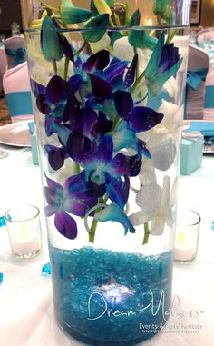 Stunning flower arrangement at a turquoise wedding party!   See more party ideas at CatchMyParty.com!