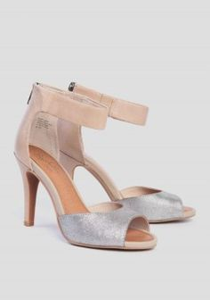 These ultra-soft nude leather heels feature a striking silver metallic peep  toe and ankle straps with a zipper heel closure. Finished with an elastic  side ...