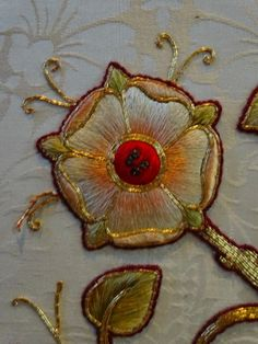 St MAry the Virgin, N.Stoke (Oxon): detail of rose from central panel of  white altar frontal