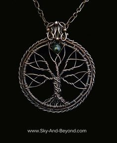 """Rowan """"Delight Of The Eyes"""" This oxidized copper wire wrapped Tree of Life is enclosed within the eternal circle of life. Branches that form the blossoming fruits, point to the Green Tourmaline """"The soul"""". Suspended from a large link decorative copper chain, this pendant brings the wearer into """"The Delight Of The Eyes"""" of all. www.sky-and-beyond.com"""