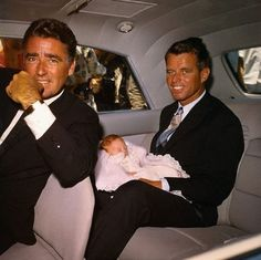 Peter Lawford with brother-in-law, Bobby Kennedy. Bobby is holding his niece, Robin Lawford, Peter's daughter.