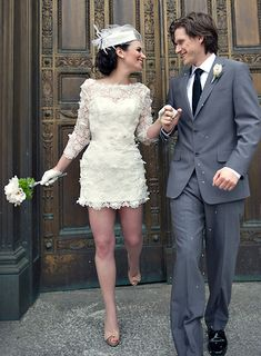 short wedding dress with lace sleeves. if I eloped, this would be the dress I'd wear.