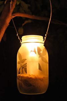 diy jar lights - add frosted design, wire, candle, and you have it.