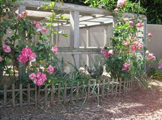 chicken coop from VintageGardenGal -  LOVE the roses growing up the side so pretty!