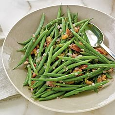 Haricots Verts with Warm Bacon Vinaigrette | MyRecipes.com-Great side dish, I didn't have walnut oil or champagne vinegar so I used a tiny bit of olive oil and white wine vinegar.  It was delicious even with the subs and we didn't have any leftovers.