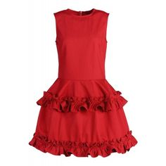 Red sleeveless dress with a fitted bodice and tiered, ruffled skirt. Crew neck. Exposed back zip closure. 100% Cotton. Dry clean. Made in the USA.