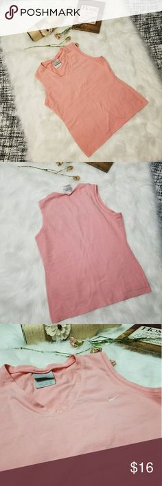 🌻🌺🌻NIKE TANK TOP!! NIKE TANK TOP!! Size medium. Has stretch to it. Pink v neck with embroidered logo on the chest. No flaws. Posh Ambassador, buy with confidence! Check out my other items to bundle and save on shipping! Offers welcome. I ship same or next day!    Inventory #RA60 Nike Tops