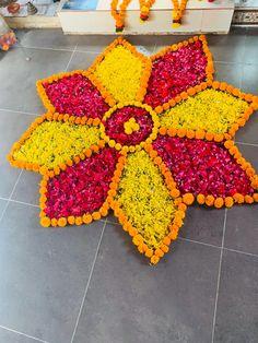 Flower rangoli at matel Mandir Desi Wedding Decor, Wedding Mandap, Wedding Decorations, Romantic Room Decoration, Flower Rangoli, Temple, Crochet Earrings, Blanket, Flowers