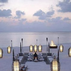 The Dusit Thani Maldives is a spectacular green dot in a sea of blue. This stunning hotel is located on Muhdhoo Island on the Maldives. Beach Dinner, Beach Party, Beach Picnic, Summer Picnic, Festa Party, Belle Photo, Dream Vacations, Places To See, The Good Place