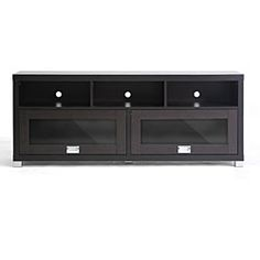 This modern TV stand with glass doors has all the space you need to keep your living room organized. The stand features three shelves for electronic components and doors that slide up for added storage, and it holds most 55-inch televisions.