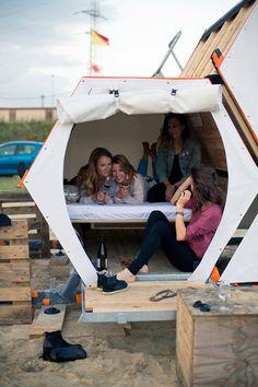 Modular honeycomb of wooden sleeping cells designed for festivals